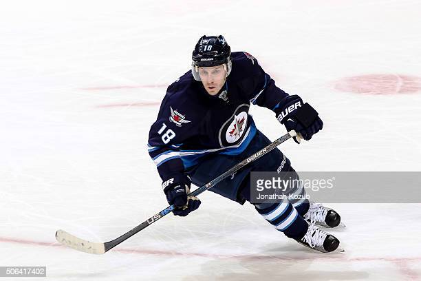 Bryan Little of the Winnipeg Jets follows the play up the ice during second period action against the Colorado Avalanche at the MTS Centre on January...
