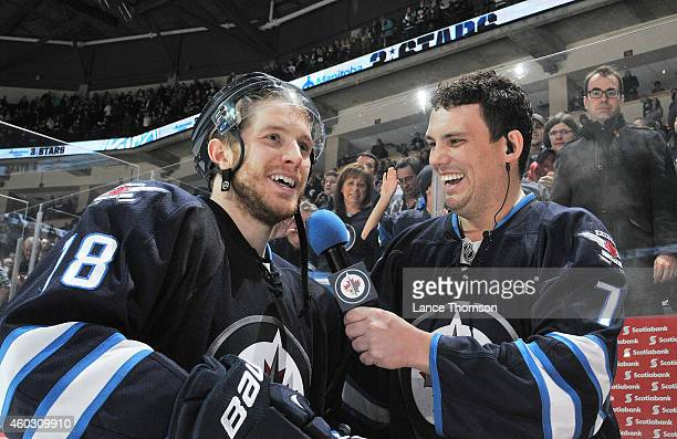 Bryan Little of the Winnipeg Jets gets interviewed by Jets Game Night Host Brody Jackson following a 62 victory over the Colorado Avalanche on...