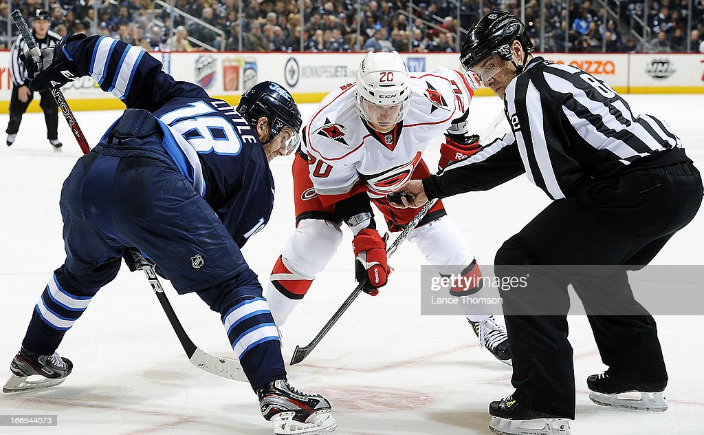 <a gi-track='captionPersonalityLinkClicked' href=/galleries/search?phrase=Bryan+Little&family=editorial&specificpeople=540533 ng-click='$event.stopPropagation()'>Bryan Little</a> #18 of the Winnipeg Jets gets set to take a third period face-off against <a gi-track='captionPersonalityLinkClicked' href=/galleries/search?phrase=Riley+Nash&family=editorial&specificpeople=4324981 ng-click='$event.stopPropagation()'>Riley Nash</a> #20 of the Carolina Hurricanes at the MTS Centre on April 18, 2013 in Winnipeg, Manitoba, Canada.