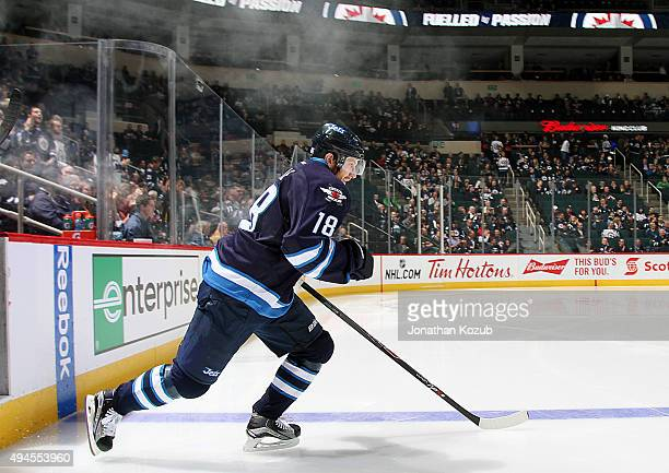 Bryan Little of the Winnipeg Jets hits the ice prior to puck drop against the Los Angeles Kings at the MTS Centre on October 27 2015 in Winnipeg...