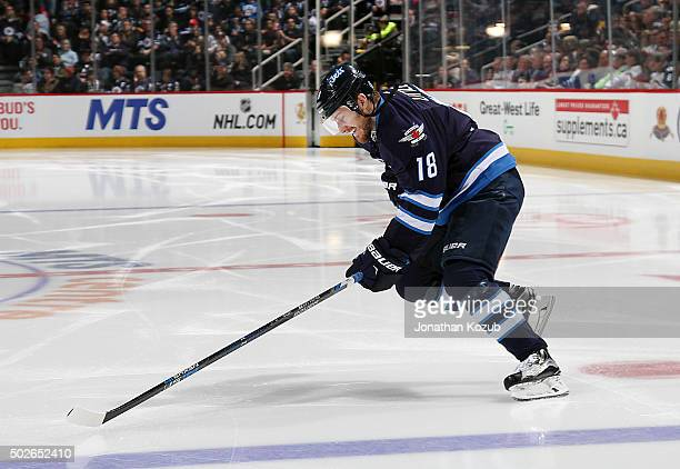 Bryan Little of the Winnipeg Jets hits the ice prior to puck drop against the Pittsburgh Penguins at the MTS Centre on December 27 2015 in Winnipeg...