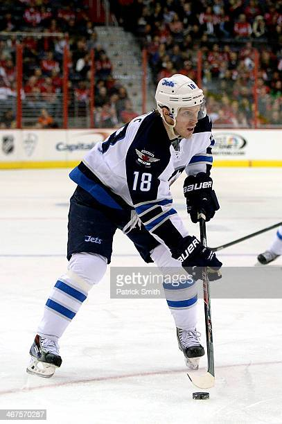 Bryan Little of the Winnipeg Jets in action against the Washington Capitals during an NHL game at the Verizon Center on February 6 2014 in Washington...