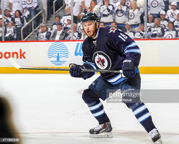 Bryan Little of the Winnipeg Jets keep an eye on the play during third period action against the Anaheim Ducks in Game Four of the Western Conference...