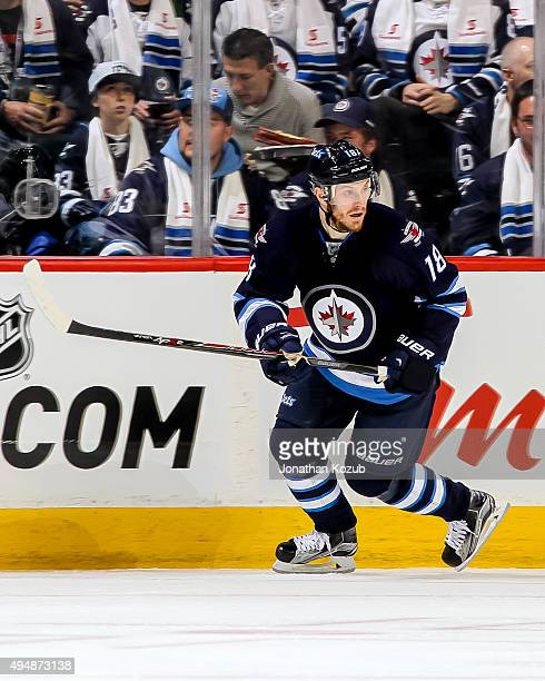 Bryan Little of the Winnipeg Jets keeps an eye on the play during second period action against the Minnesota Wild at the MTS Centre on October 25...