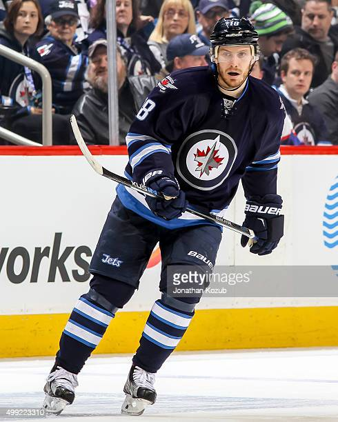 Bryan Little of the Winnipeg Jets keeps an eye on the play during firstperiod action against the Colorado Avalanche at the MTS Centre on November 23...