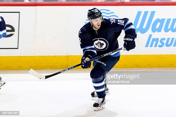 Bryan Little of the Winnipeg Jets keeps an eye on the play during third period action against the Columbus Blue Jackets at the MTS Centre on December...