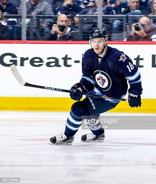Bryan Little of the Winnipeg Jets keeps an eye on the play during third period action against the New York Islanders at the MTS Centre on December 31...