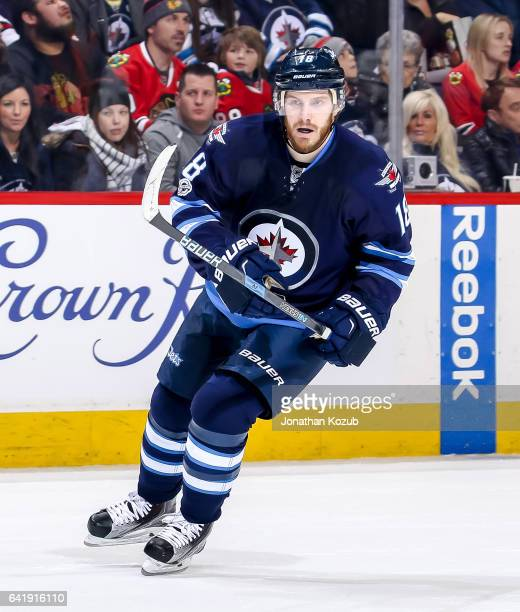 Bryan Little of the Winnipeg Jets keeps an eye on the play during first period action against the Chicago Blackhawks at the MTS Centre on February 10...