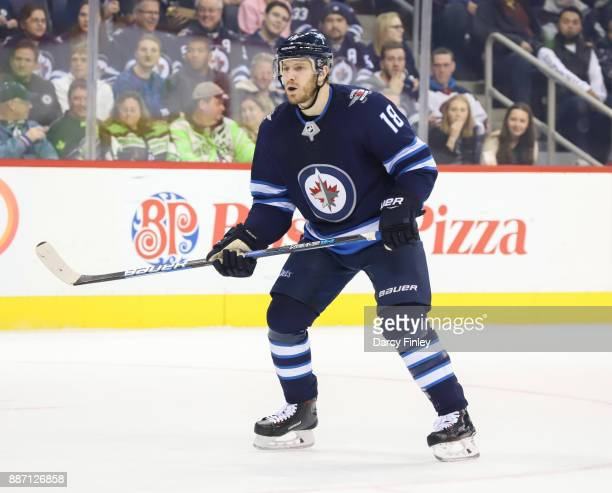 Bryan Little of the Winnipeg Jets keeps an eye on the play during first period action against the Vegas Golden Knights at the Bell MTS Place on...