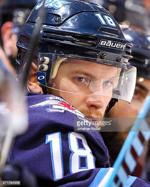 Bryan Little of the Winnipeg Jets looks on from the bench during thirdperiod action against the Anaheim Ducks in Game Three of the Western Conference...