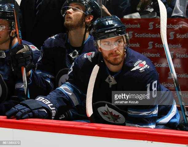 Bryan Little of the Winnipeg Jets looks on from the bench prior to puck drop against the Carolina Hurricanes at the Bell MTS Place on October 14 2017...
