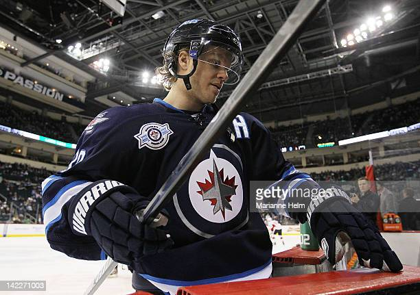 Bryan Little of the Winnipeg Jets makes his way off the ice and back to the dressing room after warming up before a game against the Ottawa Senators...