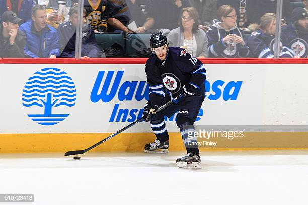 Bryan Little of the Winnipeg Jets plays the puck along the boards during second period action against the Boston Bruins at the MTS Centre on February...