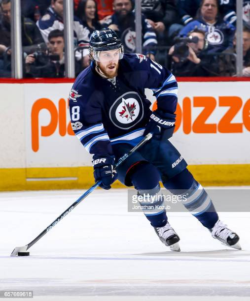 Bryan Little of the Winnipeg Jets plays the puck down the ice during second period action against the Philadelphia Flyers at the MTS Centre on March...