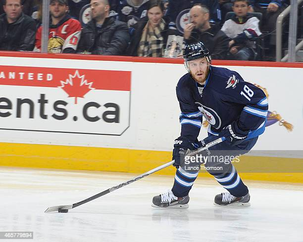 Bryan Little of the Winnipeg Jets plays the puck up the ice during first period action against the Ottawa Senators on March 4 2015 at the MTS Centre...