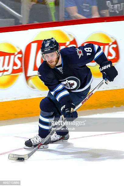 Bryan Little of the Winnipeg Jets plays the puck up the ice during third period action against the Vancouver Canucks at the MTS Centre on April 4...