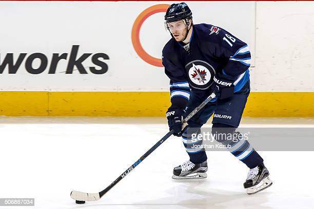 Bryan Little of the Winnipeg Jets plays the puck up the ice during third period action against the Nashville Predators at the MTS Centre on January...