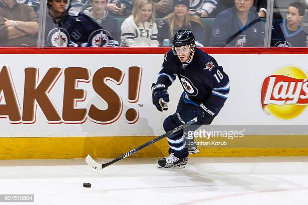 Bryan Little of the Winnipeg Jets plays the puck up the ice during third period action against the Arizona Coyotes at the MTS Centre on January 26...