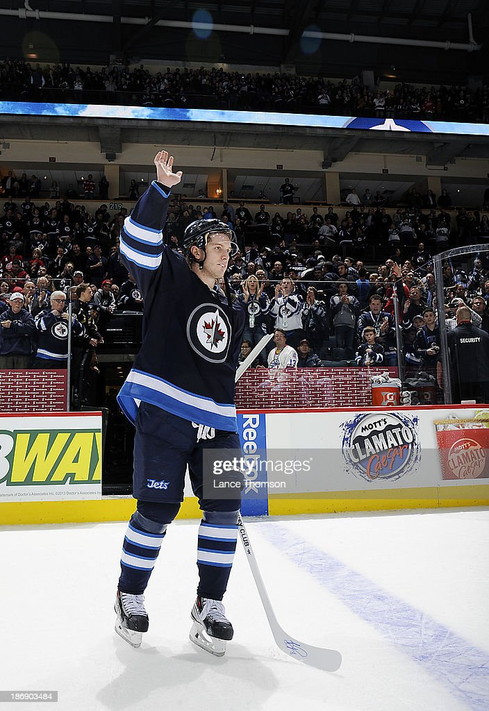 <a gi-track='captionPersonalityLinkClicked' href=/galleries/search?phrase=Bryan+Little&family=editorial&specificpeople=540533 ng-click='$event.stopPropagation()'>Bryan Little</a> #18 of the Winnipeg Jets salutes the fans after receiving third star honors following a 4-2 victory over the Detroit Red Wings at the MTS Centre on November 4, 2013 in Winnipeg, Manitoba, Canada.