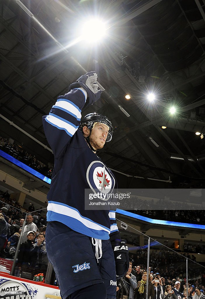 <a gi-track='captionPersonalityLinkClicked' href=/galleries/search?phrase=Bryan+Little&family=editorial&specificpeople=540533 ng-click='$event.stopPropagation()'>Bryan Little</a> #18 of the Winnipeg Jets salutes to the home fans after being named the third star of the game following a 7-2 victory over the Florida Panthers at the MTS Centre on April 11, 2013 in Winnipeg, Manitoba, Canada.