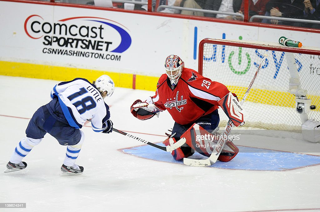 <a gi-track='captionPersonalityLinkClicked' href=/galleries/search?phrase=Bryan+Little&family=editorial&specificpeople=540533 ng-click='$event.stopPropagation()'>Bryan Little</a> #18 of the Winnipeg Jets scores during the shootout against <a gi-track='captionPersonalityLinkClicked' href=/galleries/search?phrase=Tomas+Vokoun&family=editorial&specificpeople=202179 ng-click='$event.stopPropagation()'>Tomas Vokoun</a> #29 of the Washington Capitals at the Verizon Center on February 9, 2012 in Washington, DC. Winnipeg won the game 3-2 in a shootout.