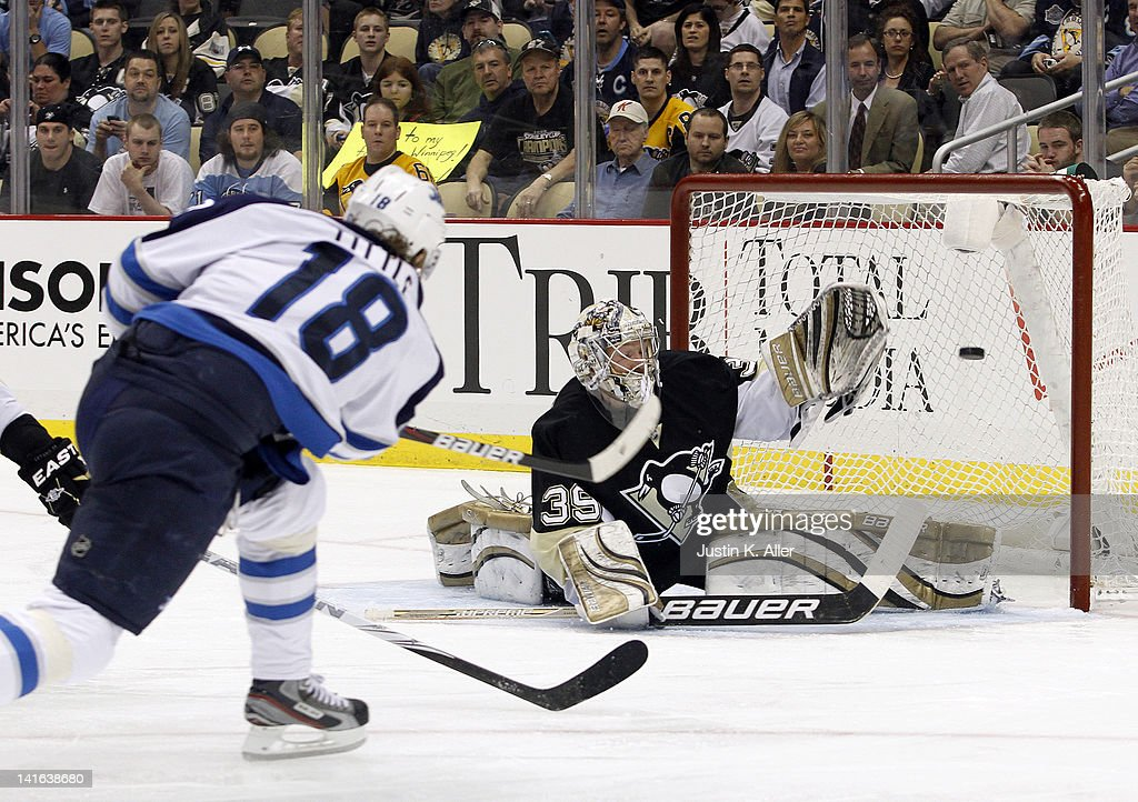 <a gi-track='captionPersonalityLinkClicked' href=/galleries/search?phrase=Bryan+Little&family=editorial&specificpeople=540533 ng-click='$event.stopPropagation()'>Bryan Little</a> #18 of the Winnipeg Jets shoots and scores past Brad Thiessen #39 of the Pittsburgh Penguins during the game at Consol Energy Center on March 20, 2012 in Pittsburgh, Pennsylvania.
