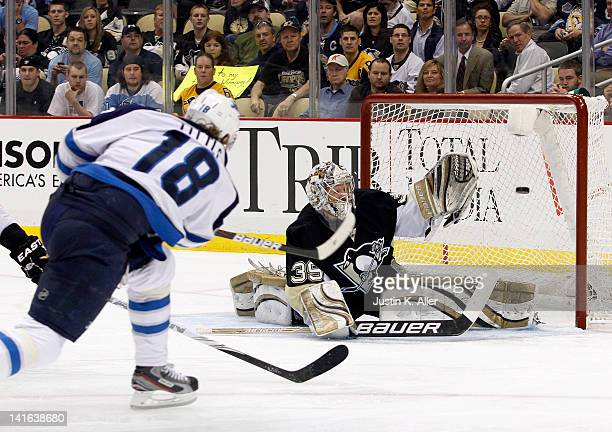 Bryan Little of the Winnipeg Jets shoots and scores past Brad Thiessen of the Pittsburgh Penguins during the game at Consol Energy Center on March 20...
