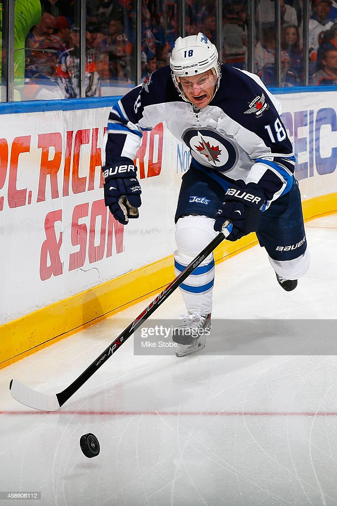 <a gi-track='captionPersonalityLinkClicked' href=/galleries/search?phrase=Bryan+Little&family=editorial&specificpeople=540533 ng-click='$event.stopPropagation()'>Bryan Little</a> #18 of the Winnipeg Jets skates against the New York Islanders at Nassau Veterans Memorial Coliseum on October 28, 2014 in Uniondale, New York. The Winnipeg Jets defeated the New York Islanders 4-3.