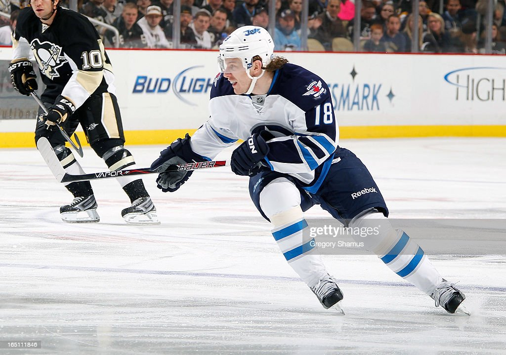 Bryan Little #18 of the Winnipeg Jets skates against the Pittsburgh Penguins on March 28, 2013 at Consol Energy Center in Pittsburgh, Pennsylvania.