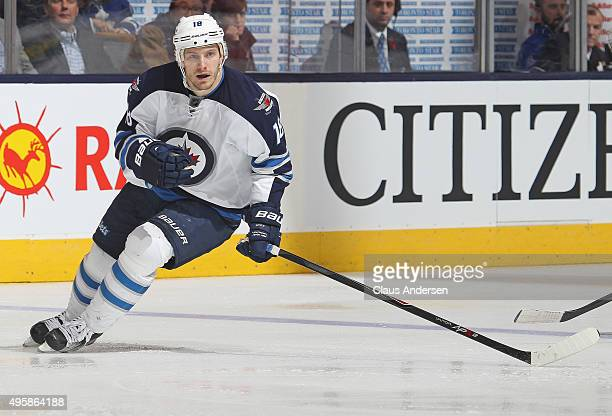 Bryan Little of the Winnipeg Jets skates against the Toronto Maple Leafs during an NHL game at the Air Canada Centre on November 4 2015 in Toronto...