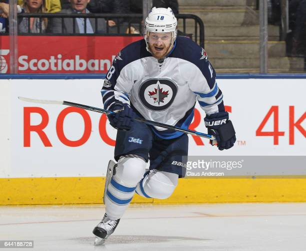Bryan Little of the Winnipeg Jets skates against the Toronto Maple Leafs during an NHL game at Air Canada Centre on February 21 2017 in London...
