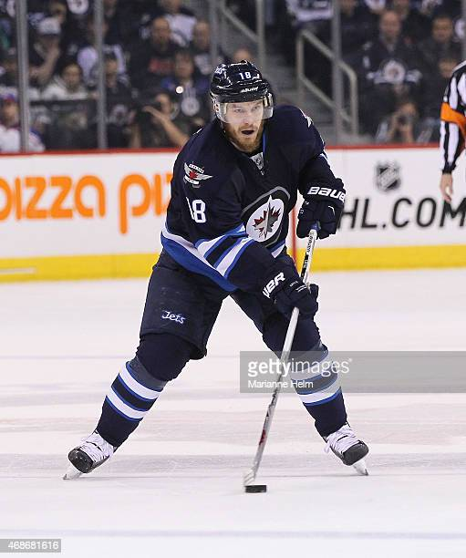 Bryan Little of the Winnipeg Jets skates down the ice in second period action in an NHL game against the New York Rangers at the MTS Centre on March...