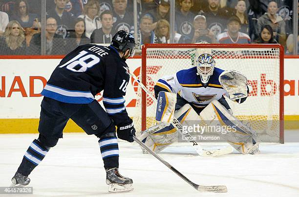 Bryan Little of the Winnipeg Jets skates in on goaltender Brian Elliott of the St Louis Blues during the shootout on February 26 2015 at the MTS...