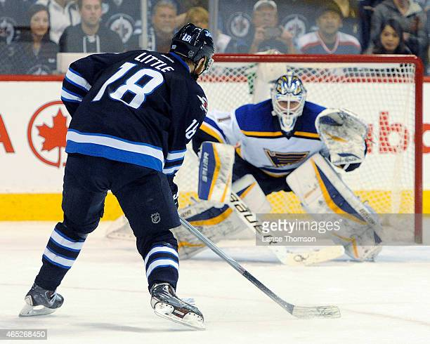 Bryan Little of the Winnipeg Jets skates in towards goaltender Brian Elliott of the St Louis Blues during the shootout on February 26 2015 at the MTS...