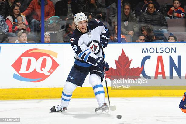 Bryan Little of the Winnipeg Jets skates on the ice in a game against the Edmonton Oilers on December 23 2013 at Rexall Place in Edmonton Alberta...