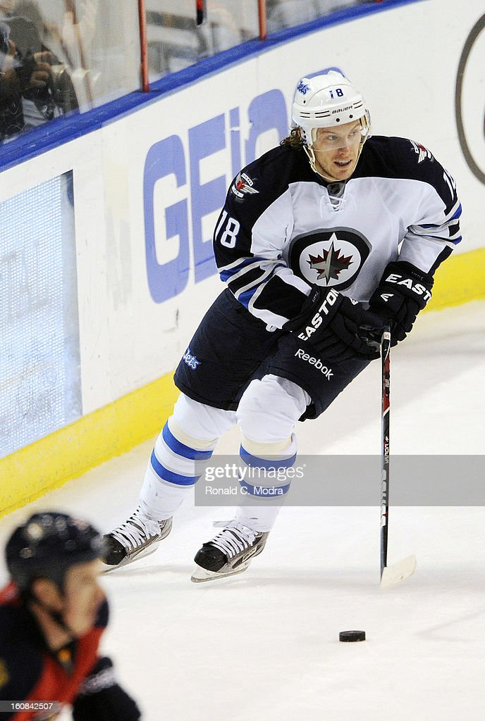 Bryan Little #18 of the Winnipeg Jets skates with the puck during a NHL game against the Florida Panthers at the BB&T Center on January 31, 2013 in Sunrise, Florida.