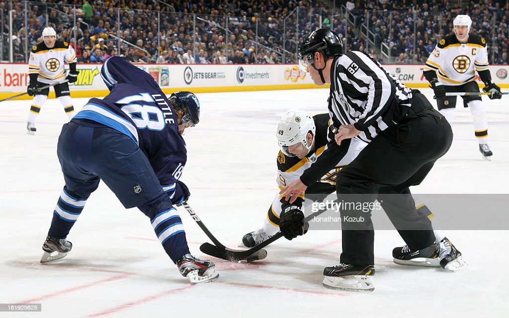Bryan Little #18 of the Winnipeg Jets takes a first period face-off against Rich Peverley #49 of the Boston Bruins at the MTS Centre on February 17, 2013 in Winnipeg, Manitoba, Canada.