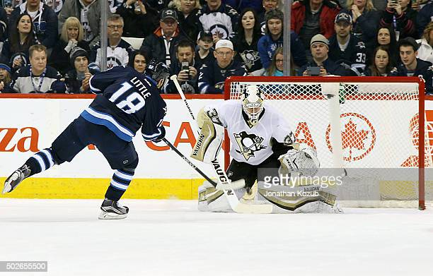 Bryan Little of the Winnipeg Jets takes a penalty shot on goaltender Jeff Zatkoff of the Pittsburgh Penguins during first period action at the MTS...