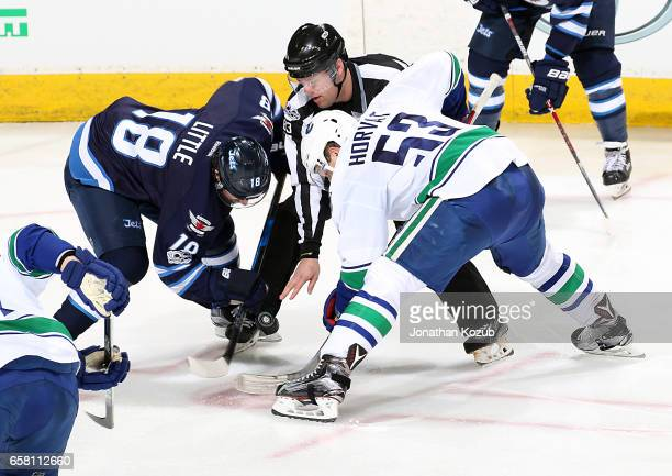Bryan Little of the Winnipeg Jets takes a second period faceoff against Bo Horvat of the Vancouver Canucks at the MTS Centre on March 26 2017 in...