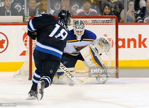 Bryan Little of the Winnipeg Jets takes a shot on goaltender Brian Elliott of the St Louis Blues during the shootout on February 26 2015 at the MTS...