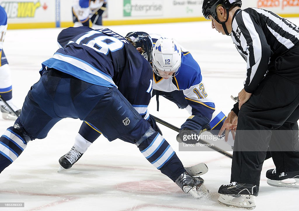 <a gi-track='captionPersonalityLinkClicked' href=/galleries/search?phrase=Bryan+Little&family=editorial&specificpeople=540533 ng-click='$event.stopPropagation()'>Bryan Little</a> #18 of the Winnipeg Jets takes a third period faceoff against <a gi-track='captionPersonalityLinkClicked' href=/galleries/search?phrase=Derek+Roy&family=editorial&specificpeople=203272 ng-click='$event.stopPropagation()'>Derek Roy</a> #12 of the St. Louis Blues at the MTS Centre on October 18, 2013 in Winnipeg, Manitoba, Canada.