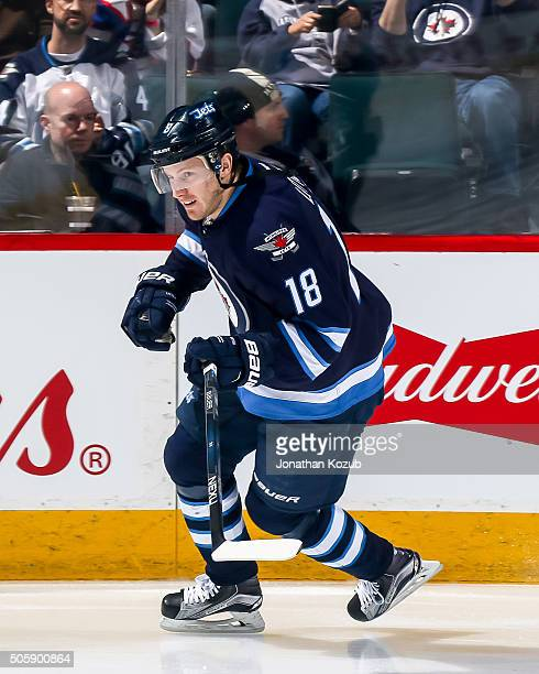 Bryan Little of the Winnipeg Jets takes part in the pregame warm up prior to NHL action against the Nashville Predators at the MTS Centre on January...