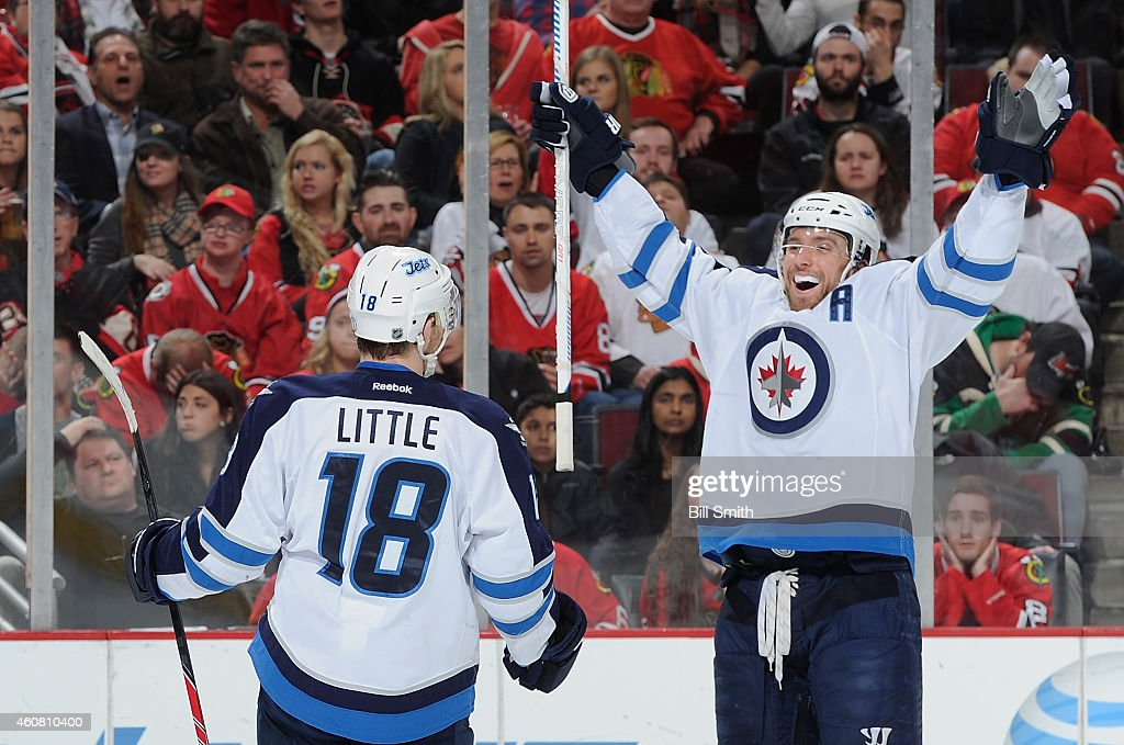 <a gi-track='captionPersonalityLinkClicked' href=/galleries/search?phrase=Bryan+Little&family=editorial&specificpeople=540533 ng-click='$event.stopPropagation()'>Bryan Little</a> #18 of the Winnipeg Jets turns to celebrate with <a gi-track='captionPersonalityLinkClicked' href=/galleries/search?phrase=Blake+Wheeler&family=editorial&specificpeople=716703 ng-click='$event.stopPropagation()'>Blake Wheeler</a> #26 after scoring against the Chicago Blackhawks in the first period during the NHL game at the United Center on December 23, 2014 in Chicago, Illinois.