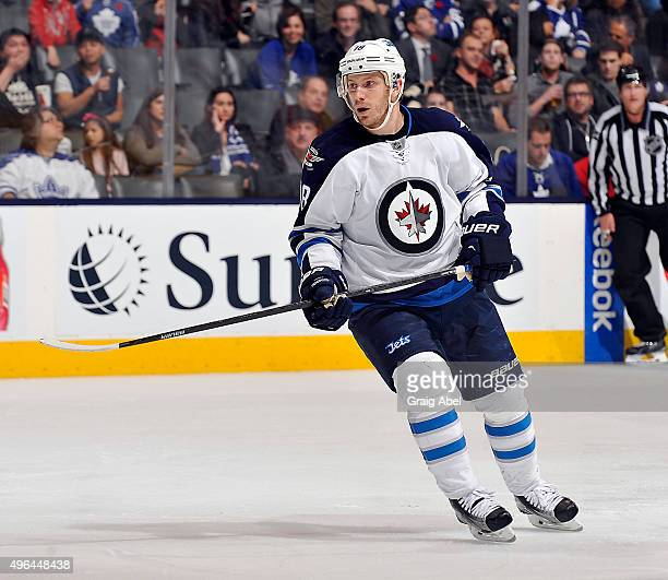 Bryan Little of the Winnipeg Jets turns up ice against the Toronto Maple Leafs during game action on November 4 2015 at Air Canada Centre in Toronto...