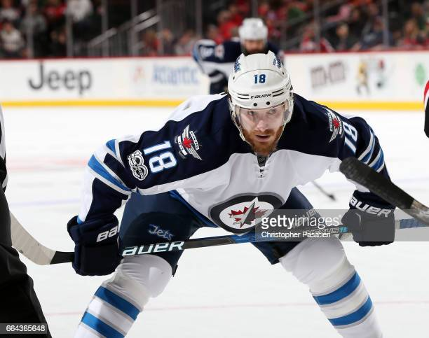 Bryan Little of the Winnipeg Jets waits for a face off during the game against the New Jersey Devils on March 28 2017 at the Prudential Center in...