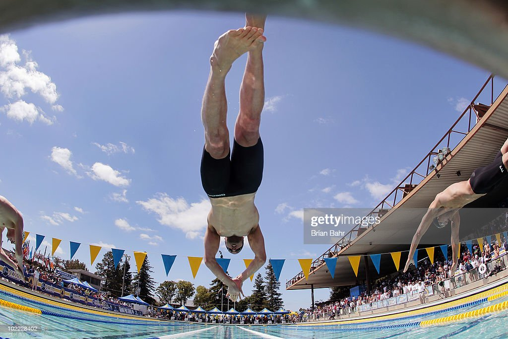 Bryan Lundquist (C) and Matthew Grevers (R) launch off the blocks in the 17th heat of the mens 50 meter freestyle at the XLIII Santa Clara International Invitational, a USA Swimming Grand Prix event, on June 19, 2010 in Santa Clara, California.
