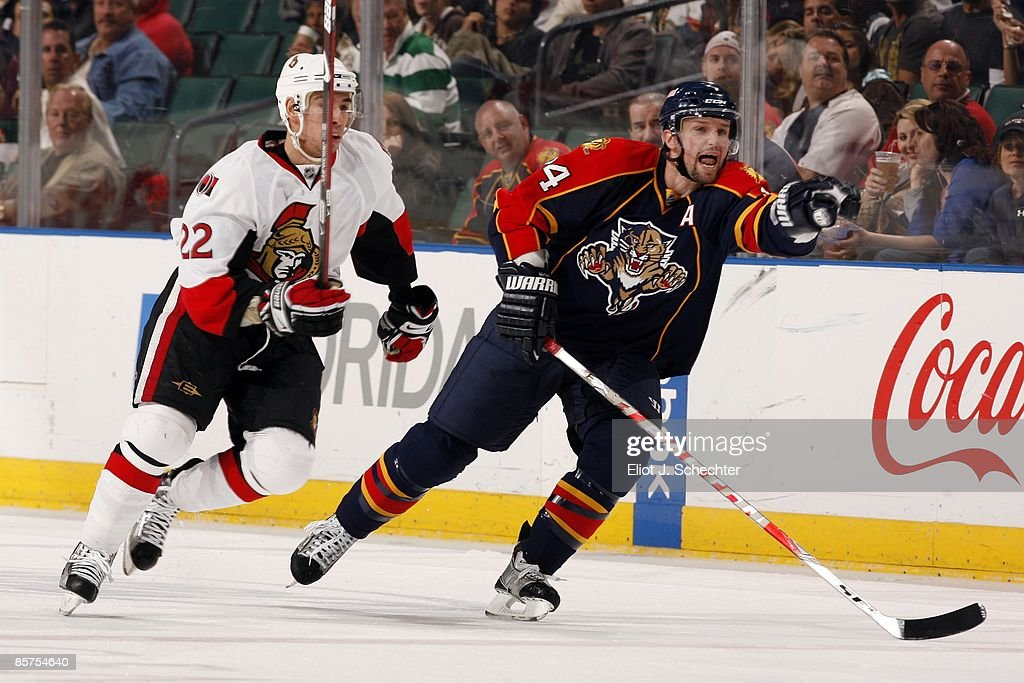 Bryan McCabe of the Florida Panthers skates against Chris Kelly of the Ottawa Senators at the Bank Atlantic Center on March 31 2009 in Sunrise Florida