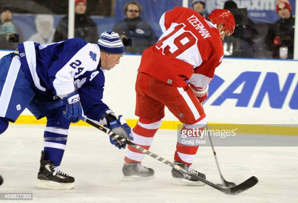 Bryan McCabe of the Toronto Maple Leafs Alumni chases down Steve Yzerman of the Detroit Red Wings Alumni during game action on December 31 2013 at...
