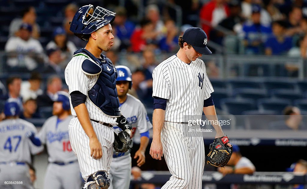 Bryan Mitchell #55 and catcher Gary Sanchez #24 of the New York Yankees look on after two runs scored in the second inning on an error against the Los Angeles Dodgers at Yankee Stadium on September 12, 2016 in the Bronx borough of New York City.