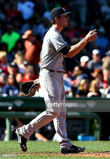 Bryan Mitchell of the New York Yankees reacts against the Boston Red Sox during a game at Fenway Park on September 27 2014 in Boston Massachusetts